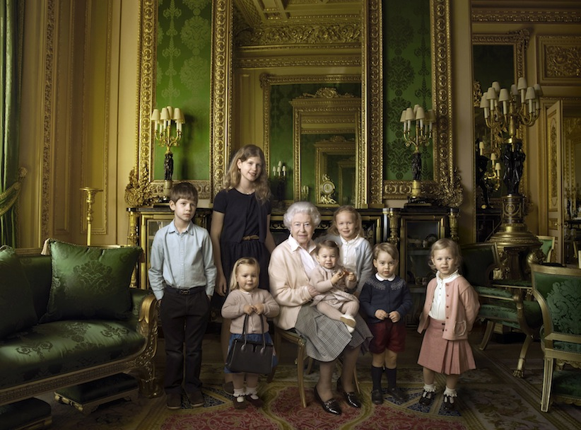 This official photograph, released by Buckingham Palace on Wednesday April 20, 2016, to mark her 90th birthday, shows Queen Elizabeth II with her five great-grandchildren and her two youngest grandchildren in the Green Drawing Room, part of Windsor Castle's semi-State apartments in Windsor England. (© 2016 Annie Leibovitz via AP) MANDATORY CREDIT