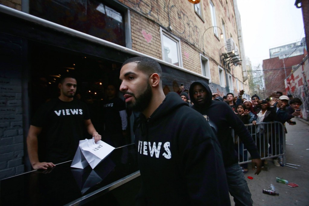 Toronto rapper Drake leaves a Queen St. West pop up shop where he was handing out T-shirts to promote his album 'Views' in Toronto on Sunday, April 24, 2016. THE CANADIAN PRESS/Cole Burston