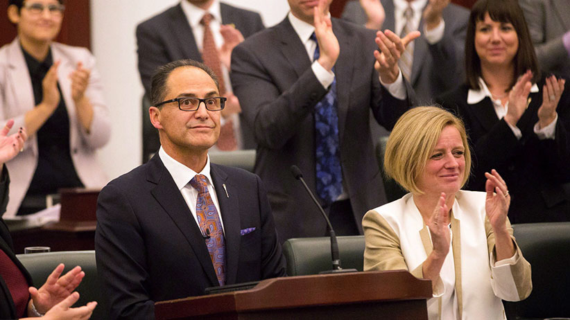 Alberta Finance Minister Joe Ceci, centre, receives a round of appause after delivering the 2015 provincial budget at the Legislative Assembly in Edmonton on Tuesday, Oct. 27, 2015. (Topher Seguin/CP)