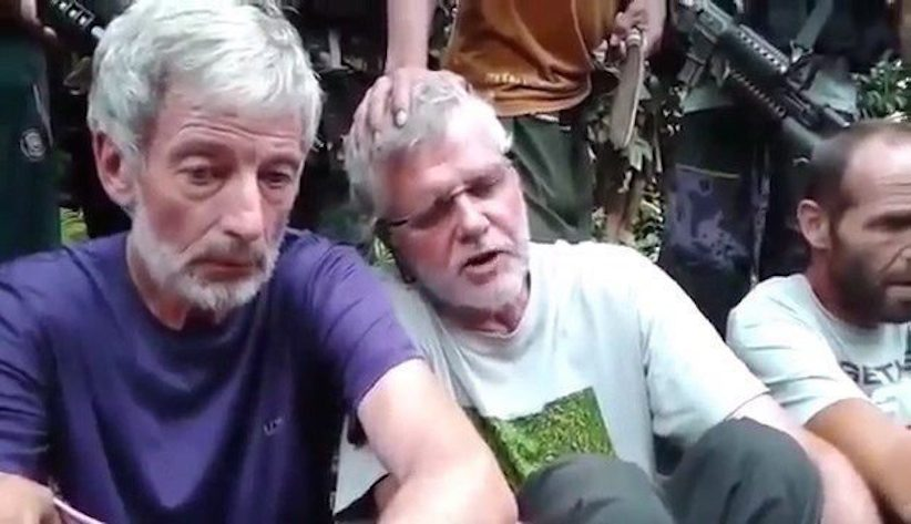 Canadians Robert Hall, left, and John Ridsdel are seen in this still image taken from an undated militant video. Police said the head of a Caucasian male was recovered Monday night in the southern Philippines and DNA tests will be conducted to determine whether it belongs to one of three Western hostages who had been threatened with beheading by ransom-seeking Muslim extremists.Two Canadians -- Ridsdel and Hall --were among the hostages. THE CANADIAN PRESS/HO via Youtube