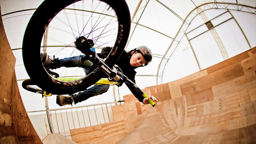 Kid biking inside. (Whistler Blackcomb)