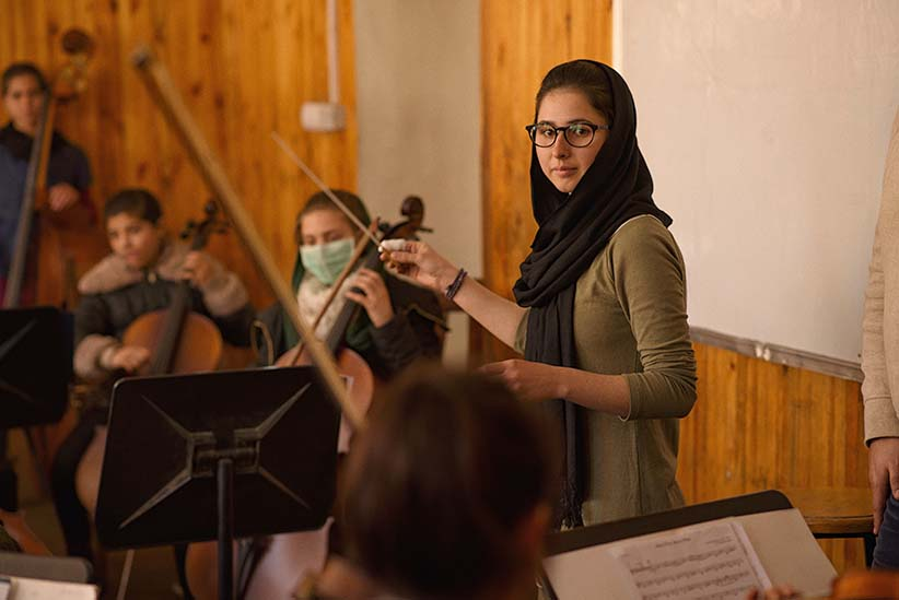 Negin Khpolwak (19) is the conductor of Afghanistan's first all female orchestra, photographer here during a rehearsal at the Afghan National Institute of Music, in the capital, Kabul. (Photograph by Andrew Quilty)