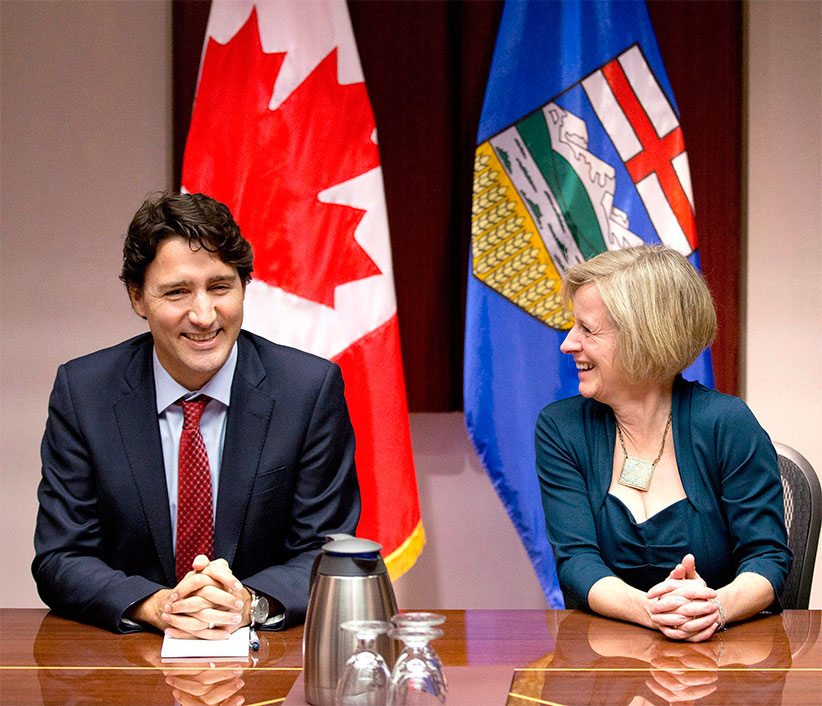 Prime Minister Justin Trudeau, left, and Alberta Premier Rachel Notley chat prior to a roundtable meeting with oil and gas producers in Calgary, Alberta, on Thursday, Feb. 4, 2016. (Larry MacDougal/CP)