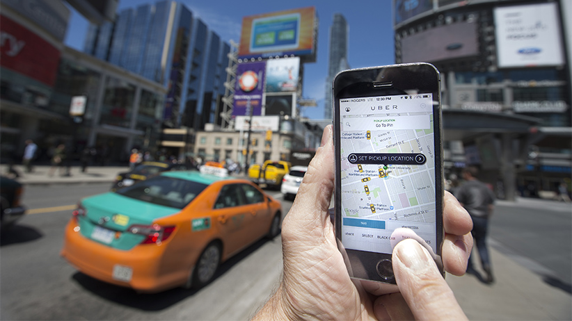 Photographed at Dundas Square, Toronto, Uber taxi service is a new way to travel around the city. Request and payment are all made using an app. (Bernard Weil/Toronto Star/Getty)