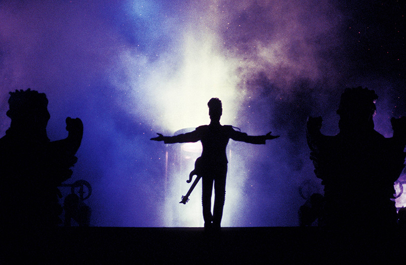 A silhouette of Prince performing on stage. (Rico D'Rozario/Redferns/Getty Images)