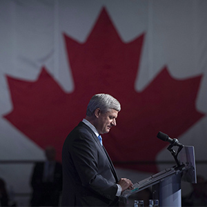 Conservative leader Stephen Harper pauses for a moment as he addresses the crowd on election night in Calgary, Ab. Monday Oct. 19, 2015.  (Jonathan Hayward/CP)