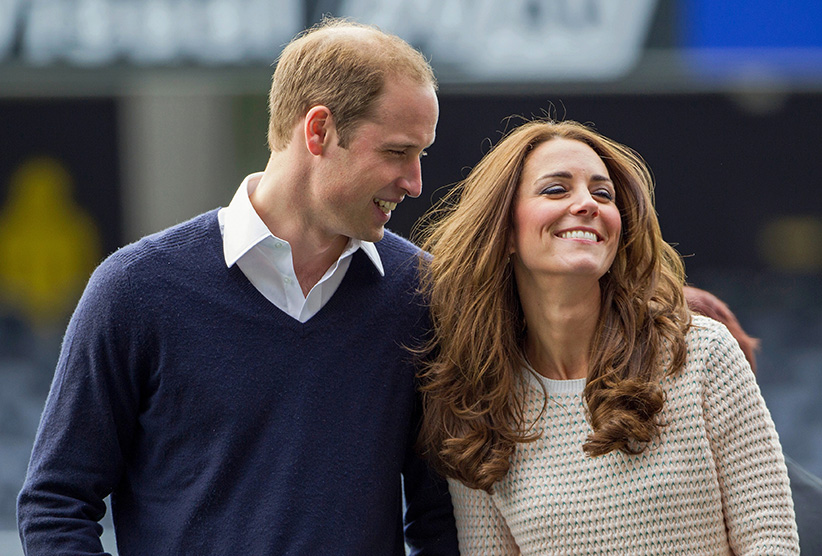 Catherine (R), Duchess of Cambridge, and her husband, Britain's Prince William, laugh as they watch a young players' rugby tournament held at Forsyth Barr Stadium in Dunedin April 13, 2014. Prince William and his wife are undertaking a 19-day official visit to New Zealand and Australia with their son, Prince George. (David Rowland/Reuters)