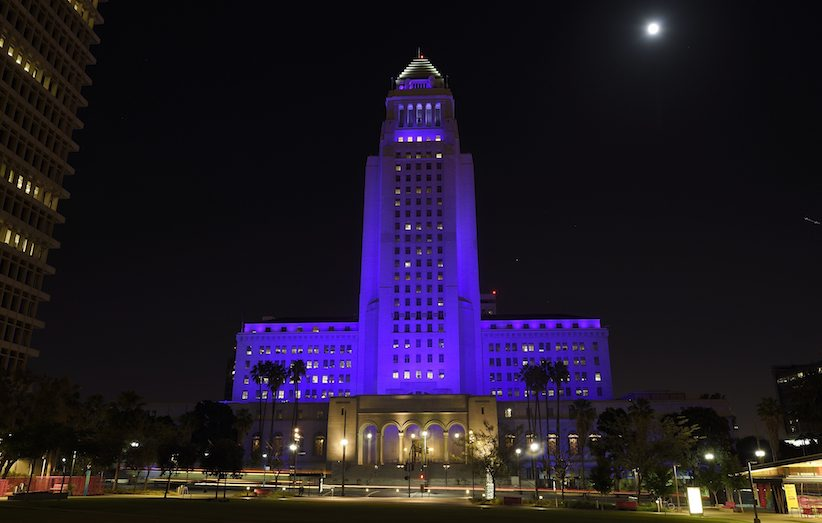 Los Angeles city hall is lit up in purple as a tribute to the late pop musician Prince, Saturday, April 23, 2016, in Los Angeles. Prince passed away at his home in suburban Minneapolis at age 57 on Thursday. (AP Photo/Mark J. Terrill)
