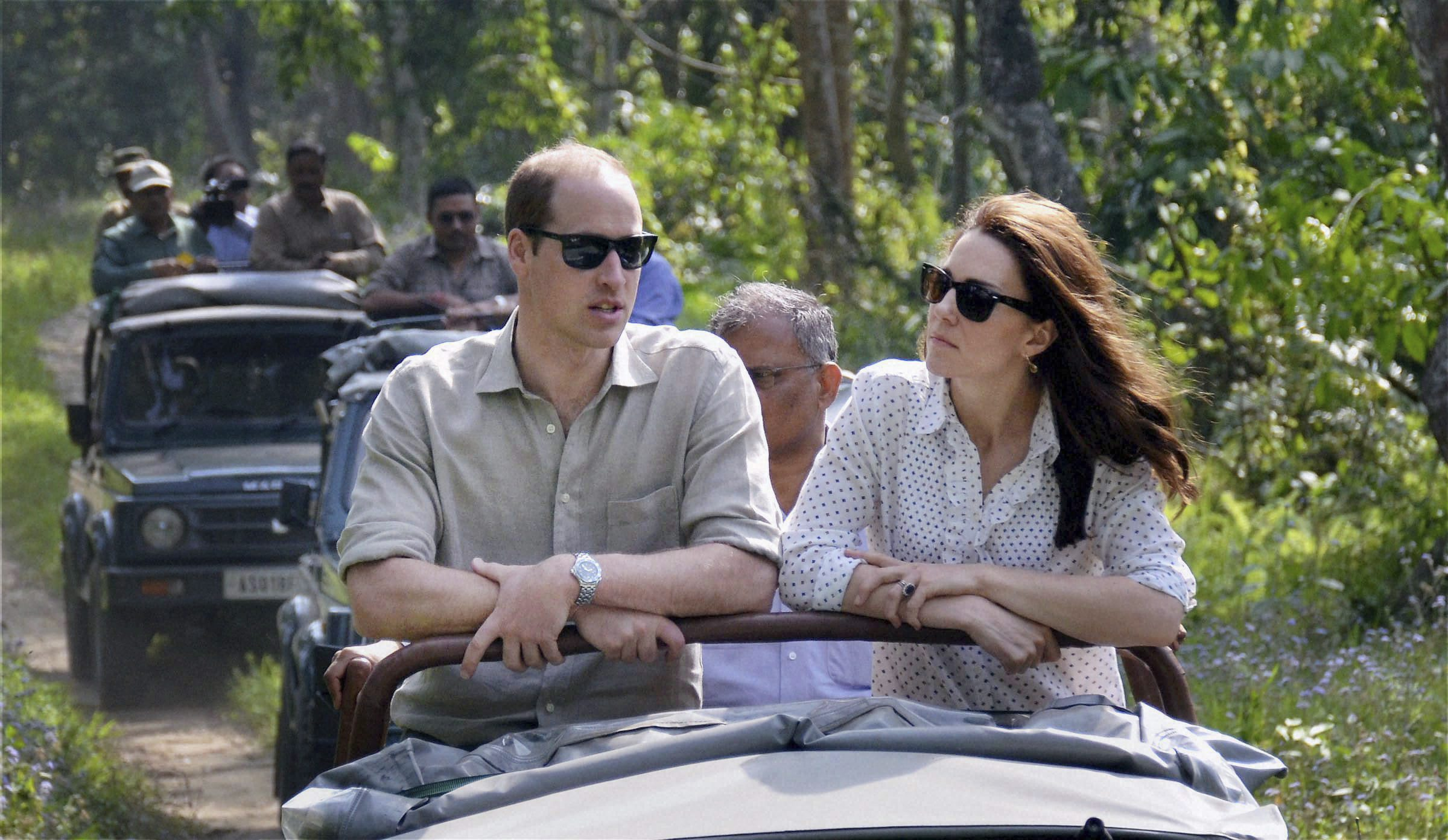 Britain's Prince William, left, and Kate, the Duchess of Cambridge take an open vehicle safari inside the Kaziranga National Park, east of Gauhati, northeastern Assam state, India, Wednesday, April 13, 2016. The royal couple spent several hours at the Kaziranga National Park in hopes of drawing attention to the plight of endangered animals, including the park's 2,200-population of a rare, one-horned rhinos.(Pool photo via AP)