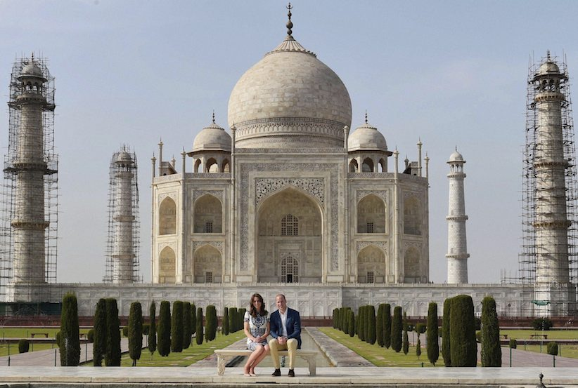 Britain's Prince William, along with his wife, Kate, the Duchess of Cambridge, pose in front of the Taj Mahal in Agra, India, Saturday, April 16, 2016. Agra is the last stop on the royal couple's weeklong visit to India and neighboring Bhutan. (Shahbaz Khan /Press Trust of India via AP) INDIA OUT