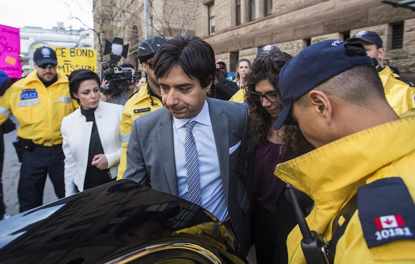 Former CBC host Jian Ghomeshi leaves court after signing a peace bond with his sister Jila, right, and his lawyer Marie Henein, left, in Toronto, Wednesday, May 11, 2016. (Mark Blinch/CP)