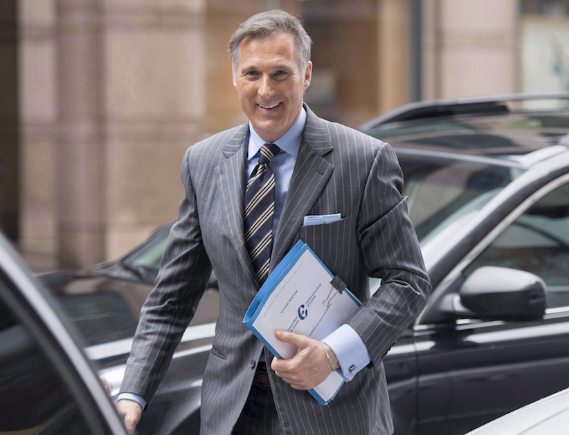 Conservative MP Maxime Bernier arrives outside the offices of the Conservative Party of Canada on Thursday, April 7, 2016 in Ottawa. (Justin Tang/CP)
