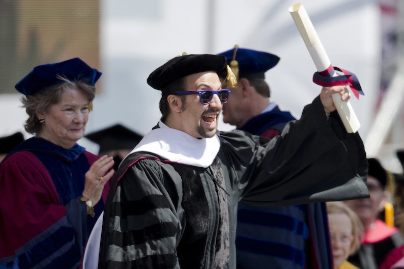 """Lin-Manuel Miranda, creator of the Broadway musical """"Hamilton,"""" gestures after receiving an an honorary degree during the University of Pennsylvania commencement ceremony, Monday, May 16, 2016, in Philadelphia. (AP Photo/Matt Rourke)"""