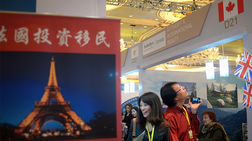 Chinese investors visit a Canadian property investment company at an international property exhibition in Beijing on May 17, 2014. (Wang Zhao/AFP/Getty)