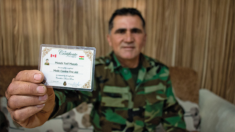 Erbil, Iraq: Mustafa Yusif Mustafa, a medic with the Zeravani forces shows a laminated version of the training certificate he received from Canadian special forces stationed in the Kurdistan Region of northern Iraq. Canada's training mission has focused on the Zeravani, a security force attached to the Kurdistan Region's Interior Ministry and considered loyal to the Kurdistan Democratic Party, or KDP. Other political groups complain that Canada has played favourites, arming and training forces that have political ties at the expense of Kurdish unity. (Photograph by Adnan R. Khan)