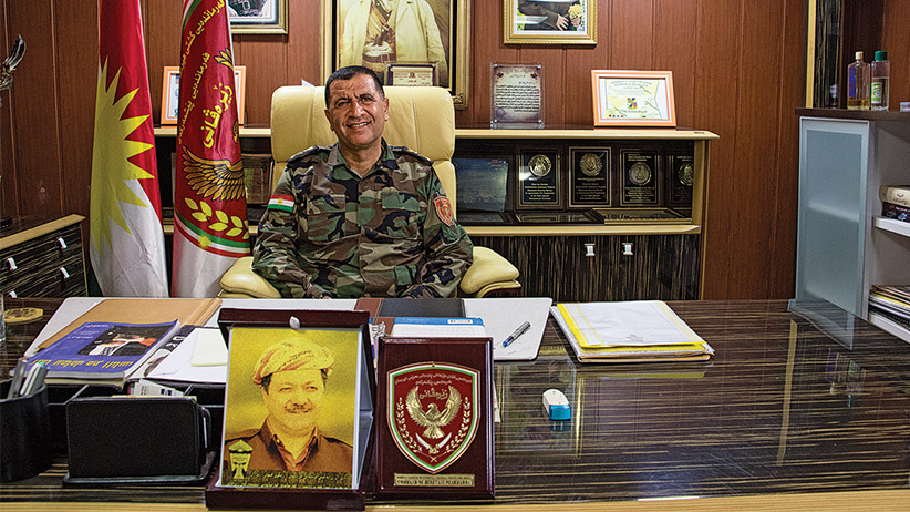 Erbil, Iraq: Major General Aziz Waisi, the head of the Zeravani forces in his office surrounded by portraits of Massoud and Mustafa Barzani, the father and son leaders of the Kurdistan Democratic Party, or KDP, at the main Zeravani base a few kilometres west of Erbil, the capital of Iraq's Kurdistan Region. Canadian special forces stationed in the Kurdistan Region of northern Iraq have focused their training and supply mission on the Zeravani, a security force attached to the Kurdistan Region's Interior Ministry and considered loyal to the KDP. Other political groups complain that Canada has played favourites, arming and training forces that have political ties at the expense of Kurdish unity. (Photograph by Adnan R. Khan)