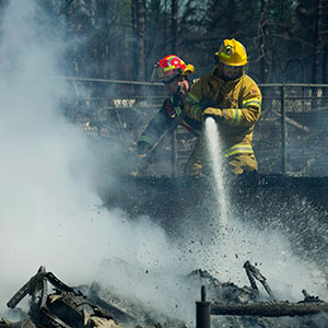 Firefighters work on the smouldering remains of houses in Slave Lake, Alberta, on Monday, May 16, 2011. Whole neighbourhoods were flattened by firestorm that swept through the town of 7,000 destroying upwards of 40% of the buildings. (Ian Jackson/CP)
