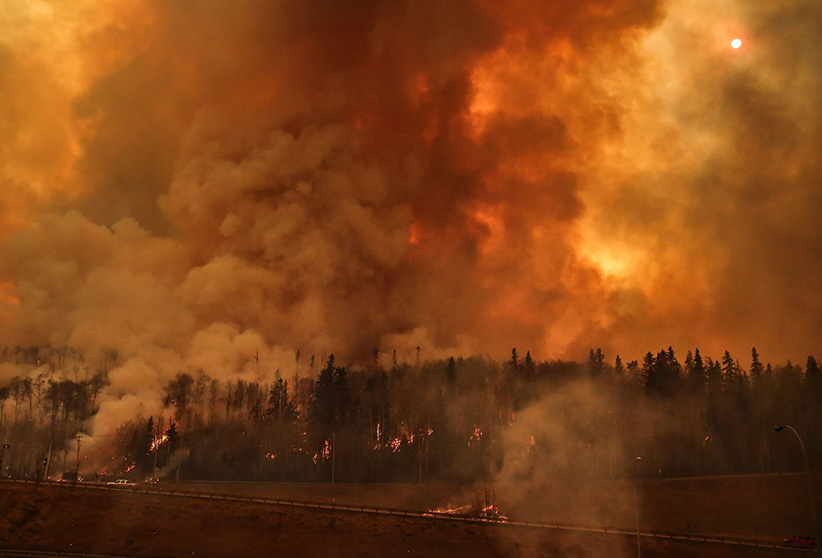 Fire seen from the highway in Fort McMurray, May 4, 2016. (Serghei Cebotari)