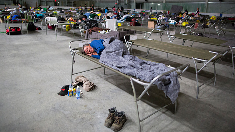 Residents of Fort McMurray get some rest in on cots at the Bold Centre in Lac La Biche, AB after being evacuated from fires that have taken over northern Alberta on Wednesday, May 04, 2016 . (Photograph by Chris Bolin)