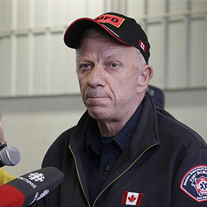 Fort McMurray, Alberta, fire chief Darby Allen speaks to members of the media at a fire station in Fort McMurray, Monday, May 9, 2016. A break in the weather has officials optimistic they have reached a turning point on getting a handle on the massive wildfire. Rachel La Corte/AP