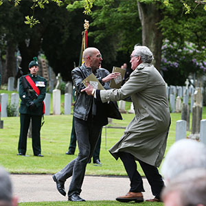 "Canadian Ambassador to Ireland Kevin Vickers, right, wrestles with a protester during a State ceremony to remember the British soldiers who died during the Easter Rising at Grangegorman Military Cemetery, Dublin Thursday May 26, 2016.  Vickers helped subdue a demonstrator who began chanting ""insult"" at the service commemorating more than 100 British soldiers killed trying to suppress the Easter Rising a century ago. (Brian Lawless/AP)"