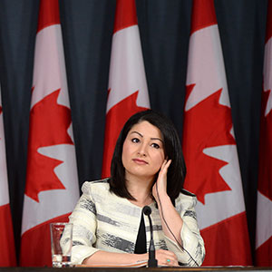 Maryam Monsef, Minister of Democratic Institutions, and Dominic LeBlanc, Leader of the Government in the House of Commons, make an announcement regarding electoral reform during a press conference at the National Press Theatre in Ottawa on Wednesday, May 11, 2016. (Sean Kilpatrick/CP)