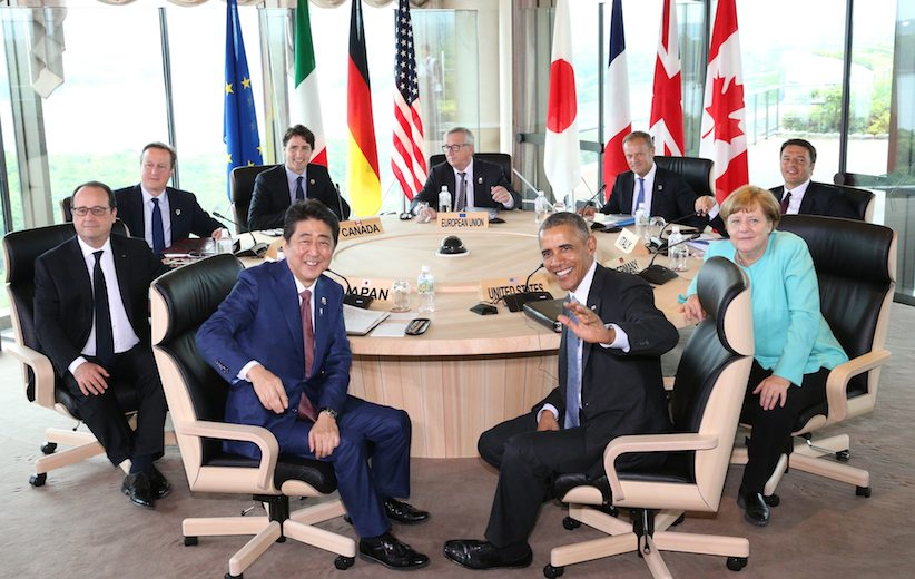 Japanese Prime Minsiter Shinzo Abe, foreground center left, and U.S. President Barack Obama, foreground center right, smile at photographers with other leaders of Group of Seven industrial nations, clockwise from left, French President Francois Hollande, British Prime Minister David Cameron, Canadian Prime Minister Justin Trudeau, European Commission President Jean-Claude Juncker, European Council President Donald Tusk, Italian Prime Minister Matteo Renzi and German Chancellor Angela Merkel, at the start of the second working session of the G-7 summit meetings in Shima, Mie Prefecture, Japan, Thursday, May 26, 2016. (Japan Pool via AP) JAPAN OUT