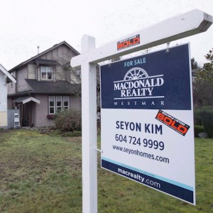 A sold home is pictured in Vancouver, B.C., Thursday, Feb. 11, 2016. Canada Mortgage and Housing Corporation says there is mounting evidence that house prices in a number of Canadian cities are out of whack with incomes and other economic fundamentals.The latest report from CMHC says there is evidence of overvaluation in nine of the 15 real estate markets included in the research. THE CANADIAN PRESS/Jonathan Hayward