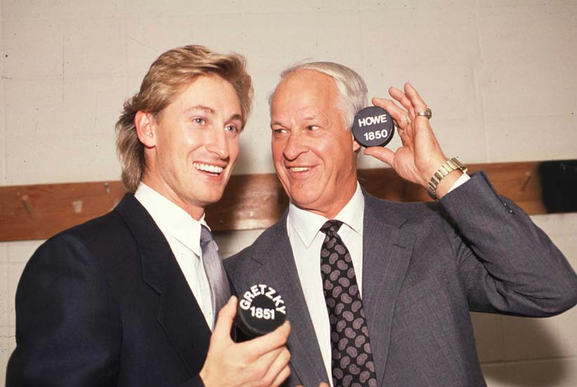 EDMONTON - OCTOBER 15: Wayne Gretzky of the Los Angeles Kings stands with Gordie Howe as they pose with the 1,851 puck that Gretkzy scored with to pass Howe as the all-time point leader in the NHL against the Edmonton Oilers on October 15, 1989 at Northlands Coliseum in Edmonton, Alberta, Canada.  (Bruce Bennett Studios/Getty Images)