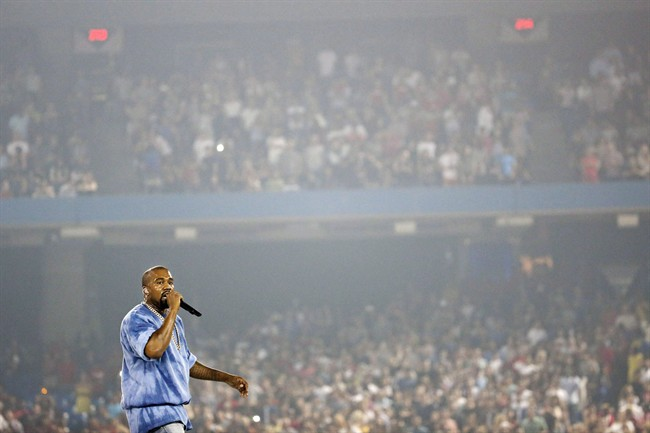 Kanye West performs during the closing ceremony of the Pan Am Games Sunday, July 26, 2015, in Toronto. THE CANADIAN PRESS/AP, Julio Cortez