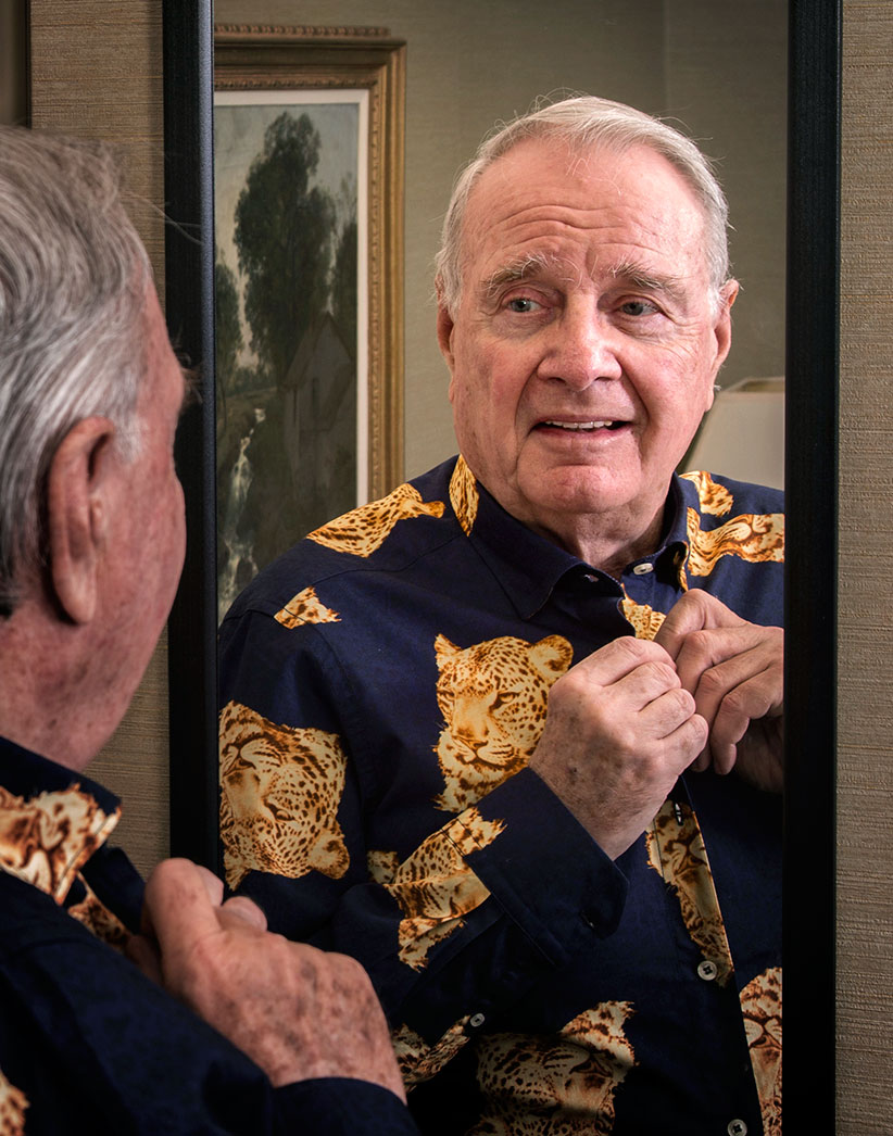 Paul Martin trying on a Paul Martin Canadian shirt. (Photograph by Roger LeMoyne)
