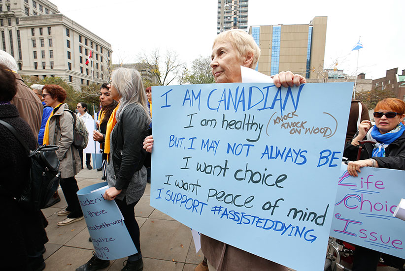 Marlene Cuthbert of Mississauga was at the Toronto rally and voiced her opinion. About 80 supporters of Dying With Dignity showed up outside of the 361 University Ave courthouse as a show of support for doctor assisted deaths - with nine other rallies across the country - coinciding with the hearing at the Supreme Court hearing on the Carter case.  Wednesday October 15, 2014. (Jack Boland/Toronto Sun/Postmedia)