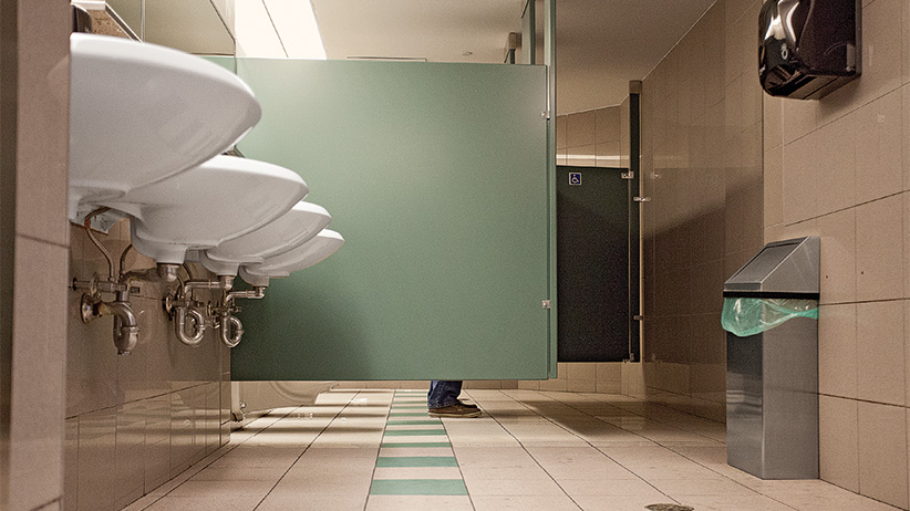 Man in a public washroom. (Photograph by Natalie Castellino)