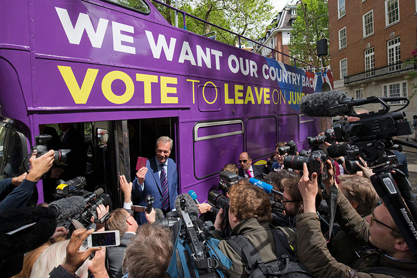 Leader of the United Kingdom Independence Party (UKIP), Nigel Farage poses for photographers holding a British passport at the launch of the party's open-top bus that will be touring the UK for the campaign to leave the European Union, ahead of the referendum, in London on May 20, 2016. The referendum for whether Great Britain stays in or leaves the EU will take place on June 23. (Justin Tallis/AFP/Getty Images)