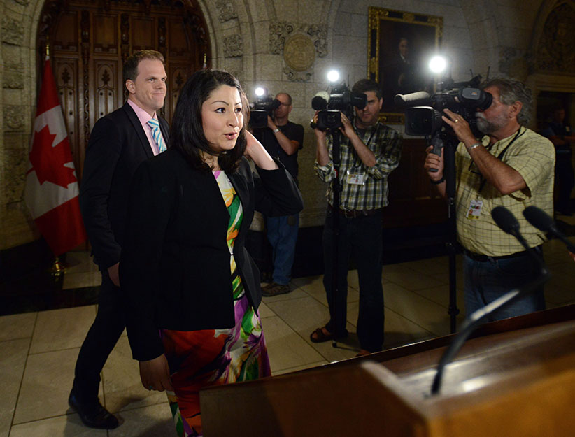 Minister of Democratic Institutions Maryam Monsef is joined by fellow MP Mark Holland, left, as they arrive to speak to reporters in the foyer of the house of commons on Parliament Hill in Ottawa on Thursday, June 2, 2016. (Sean Kilpatrick/CP)