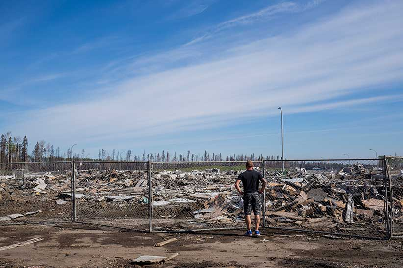 Scott Borowsky surveys the damage of his neighbourhood in Prospect Point in Fort McMurray on Thursday, June 02, 2016. He and his wife who lived at 121 Siltstone Place lost their home in the fires. (Photograph by Chris Bolin)