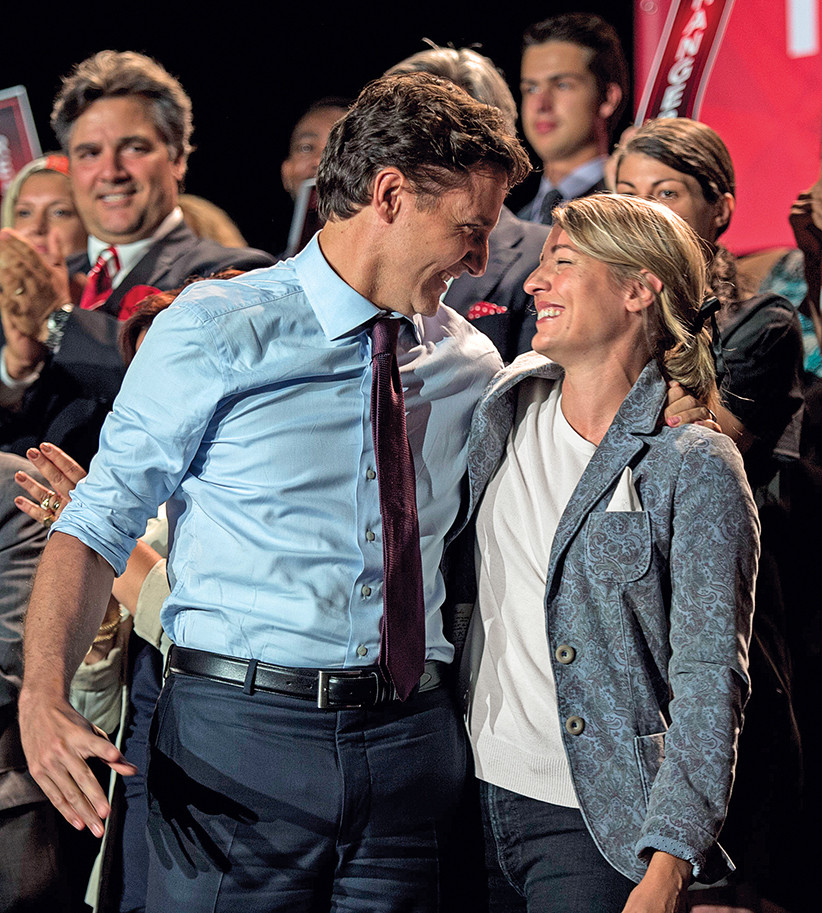 Liberal leader Justin Trudeau greets local candidate Melanie Joly during a rally Friday, August 28, 2015 in Montreal. (Paul Chiasson/CP)