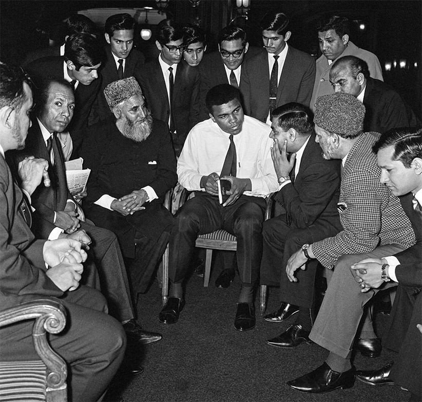 Muhammad Ali speaking to Muslims, holding a book called Towards Understanding Islam written by Sayyid Abul Ala Maududi. Circa May 1966. (Trinity Mirror/Mirrorpix/Alamy)