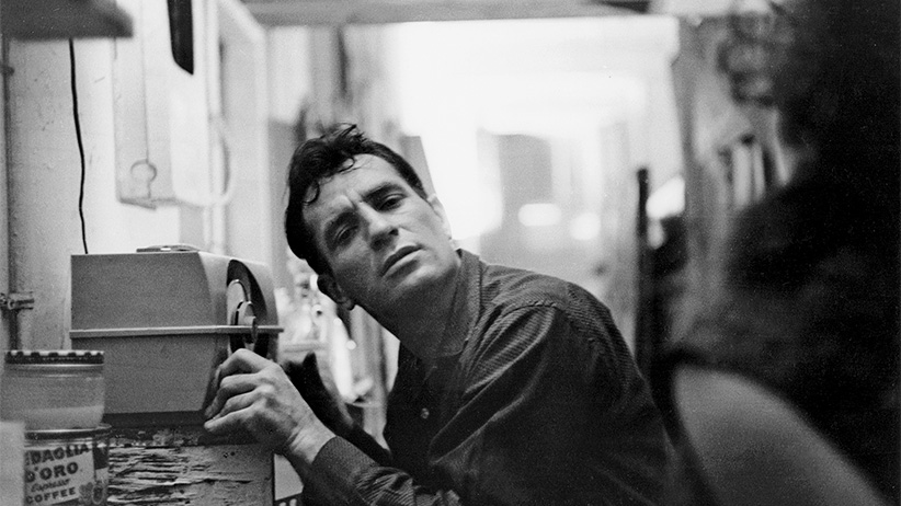 American Beat writer Jack Kerouac (1922 - 1969) leans closer to a radio to hear himself on a broadcast, 1959. (John Cohen/Getty Images)