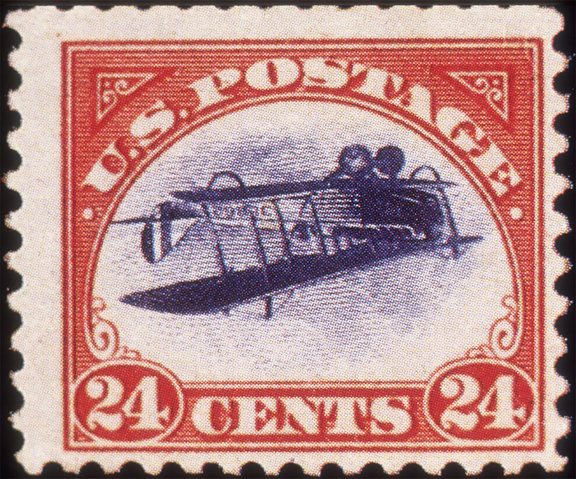 Closeup still life of the first U.S. air mail stamp, featuring a biplane flying upside down. These 24 cent stamps were called the 'Inverted Jenny.' (Blank Archives/Getty Images)