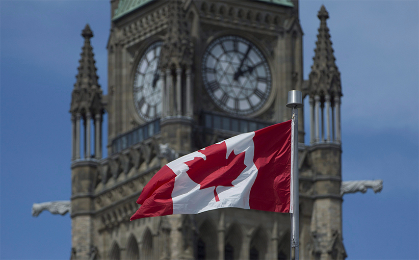 The Maple Leaf flies in front of the Peace tower on Parliament Hill. (Adrian Wyld/CP)