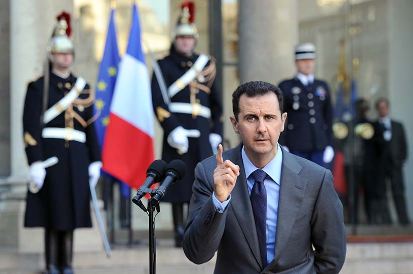 Syrian president Bashar al-Assad delivers a speech at the Elysee Palace in Paris on December 9, 2010, after sharing a working lunch with his French counterpart Nicolas Sarkozy. Al-Assad is on a two-days official visit to France. (Franck Fie/AFP/Getty Images)