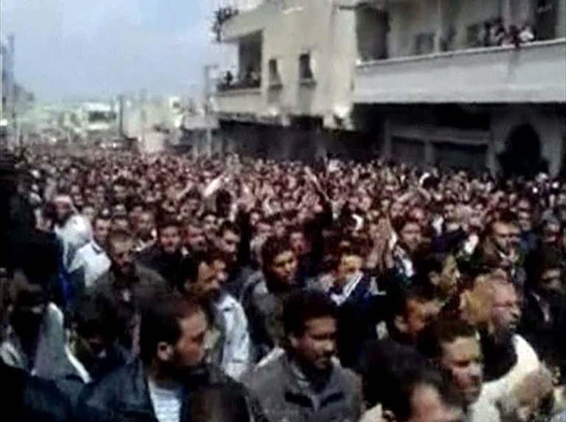 Thousands of people attend a mass funeral for pro-democracy protesters in the Syrian city of Deraa in this still image taken from an amateur video posted to a social media site on April 9, 2011. The National Organisation for Human Rights in Syria, a Syrian rights group, said on Sunday that 26 protesters had been killed in the city of Deraa and two in Homs province after security forces opened fire on a peaceful gathering on Friday. Syria has prevented news media from reporting from Deraa and mobile phones lines there appeared to be cut on Sunday. (Reuters)