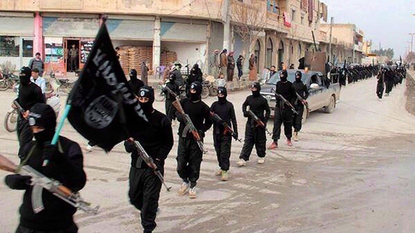 This undated file image posted on a militant website on Jan. 14, 2014, which has been verified and is consistent with other AP reporting, shows fighters from the al-Qaida linked Islamic State of Iraq and the Levant (ISIL) marching in Raqqa, Syria. (AP)