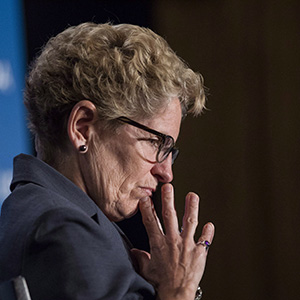 Ontario Premier Kathleen Wynne listens to remarks from Manitoba Premier Greg Selinger (not shown) at the opening of the Building Canada Up Summit in Toronto on Wednesday August 6, 2014. (Chris Young/CP)