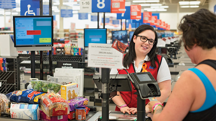 Jenna Majeau works at the Superstore in Fort McMurray, Alberta on Wednesday, June 1, 2016. Majeau graduated this year but the ceremonies and celebrations were put on hold with the fire evacuation of the city. Photograph by Amber Bracken