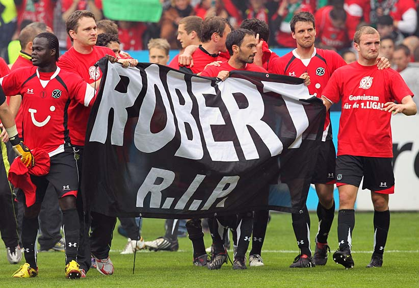 Players from Hannover celebrate and remain goalkeeper Robert Enke after the Bundesliga match between VfL Bochum and Hannover 96 at Rewirpower Stadium on May 8, 2010 in Bochum, Germany. (Bongarts/Getty Images)