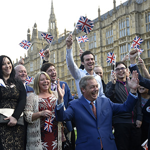 Nigel Farage (front), the leader of the United Kingdom Independence Party (UKIP) reacts with supporters, following the result of the EU referendum, outside the Houses of Parliament in London, Britain June 24, 2016. (Toby Melville/Reuters)