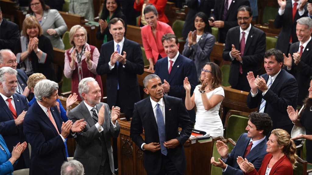 U.S. President Barack Obama, centre, is greeted by a standing ovation in the House of Commons in Ottawa on Wednesday, June 29, 2016. (Adrian Wyld/CP)