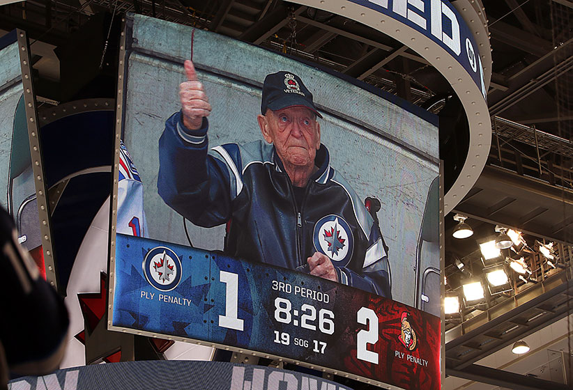 Fan favorite Veteran Len Kropioski gives a thumbs up as he is shown on the scoreboard during a third period stoppage in play between the Winnipeg Jets and the Ottawa Senators at the MTS Centre on March 30, 2016 in Winnipeg, Manitoba, Canada. Kropioski has been a mainstay at Jets games since the team returned to the city in 2011. (Jonathan Kozub/NHLI/Getty Images)